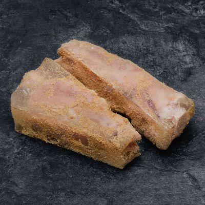 Pieds de porc cuits panés