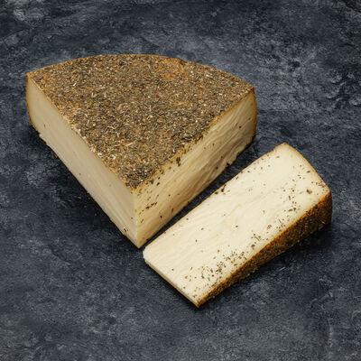 Raclette au lait pasteurisé herbes poivrées du Jura, 26% de MG,