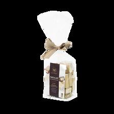 Assortiment de Nougat de Montélimar : nature, enrobés de chocolat noir, chocolat au lait aromatisé à l'orange U SAVEURS, sachet 200g