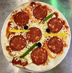 Pizza au chorizo fait sur place