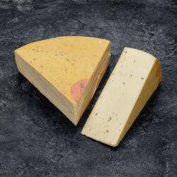 Fromage à raclette au poivre, 60 jours d'affinage, au lait pasteurisé,26% Mat.Gr.